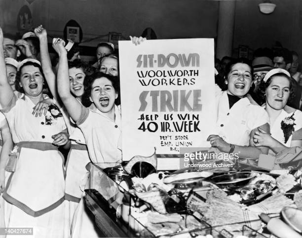 Female employees of Woolworth's holding a sign indicating they are striking for a 40 hour work week, New York, New York, 1937.