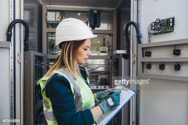 female energy station electrician engineer read notes - atomic imagery stock pictures, royalty-free photos & images