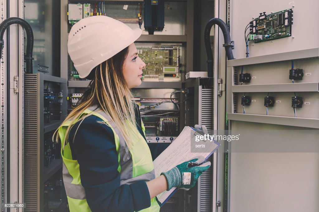 Female Energy Station Electrician Engineer Working at Energy Control Room : Stock Photo