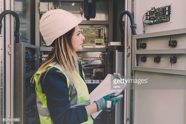 Female Energy Station Electrician Engineer Working at Energy Control Room