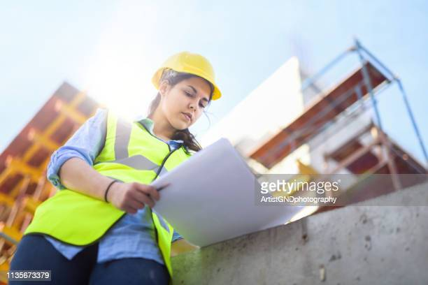 female engineeer. construction job site. - real estate developer stock pictures, royalty-free photos & images