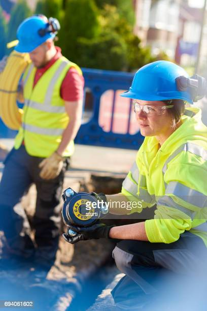 female engineer at a road dig