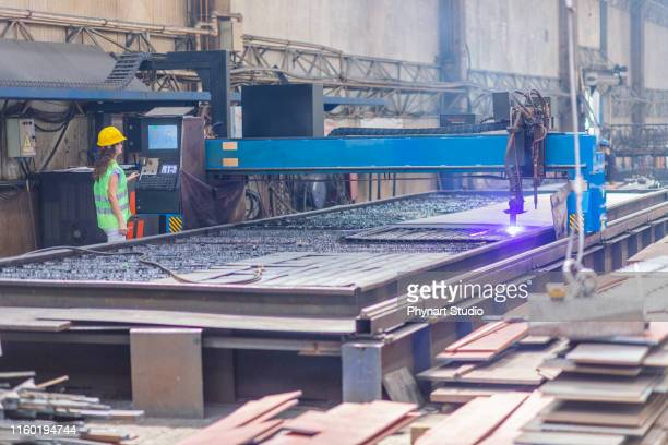 female engineer in process of controlling plasma cutting - liquid crystal display stock pictures, royalty-free photos & images