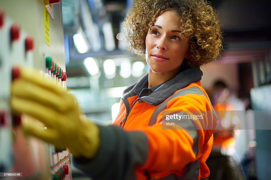 female engineer in the boiler room : Stock Photo