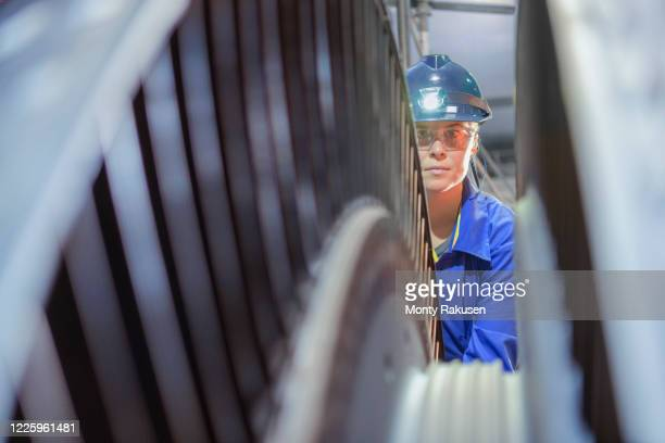 female engineer inspecting a turbine in a  nuclear power station. - atomic imagery stock pictures, royalty-free photos & images