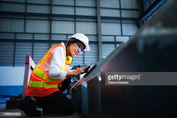 female engineer inspecting the workpiece in a steel factory. - making stock pictures, royalty-free photos & images
