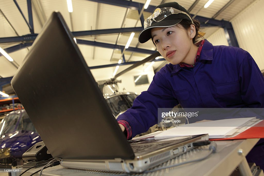 female engineer looking at laptop : Stock Photo