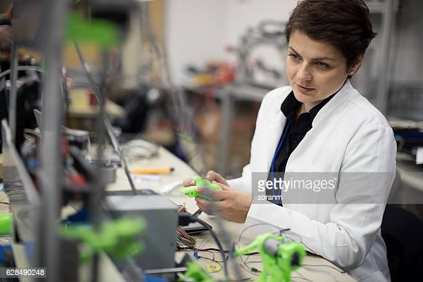 Female engineer making parts using a 3D printer