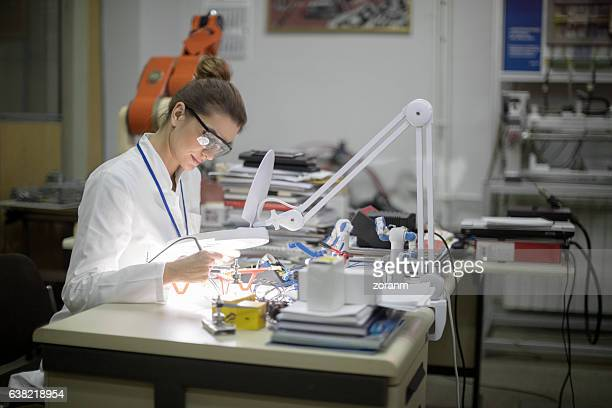 Female engineer repairing drone