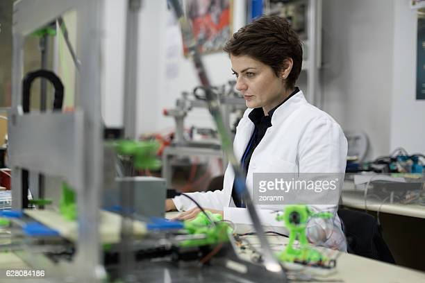 Female engineer using a 3D printer