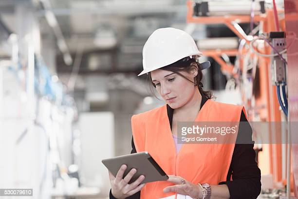 Female engineer using a digital tablet in an industrial plant, Freiburg Im Breisgau, Baden-W��rttemberg, Germany