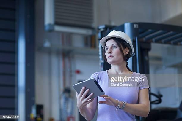 Female engineer using a digital tablet in an industrial plant, Freiburg Im Breisgau, Baden-W��rttemberg, Germany