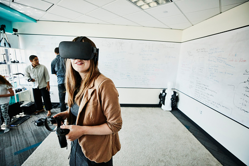 Female engineer using virtual reality headset in computer lab - gettyimageskorea