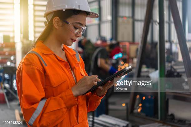 female engineer working at factory - innovation stock pictures, royalty-free photos & images