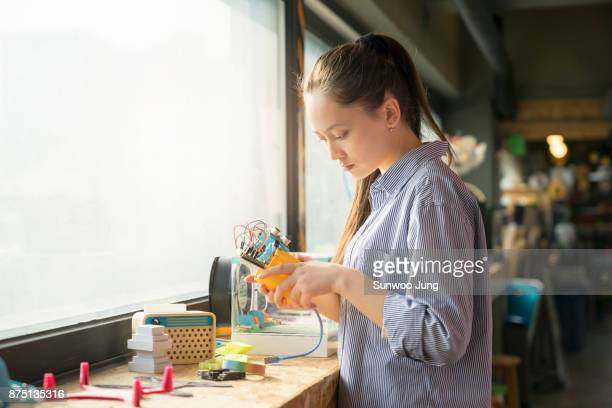 female engineer working on robotics - stem stock photos and pictures