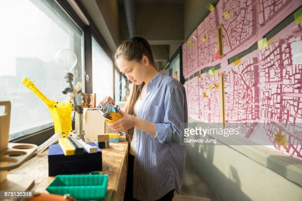Female engineer working on robotics