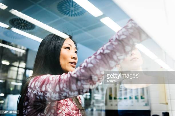 female engineers discussing - science and technology stock pictures, royalty-free photos & images