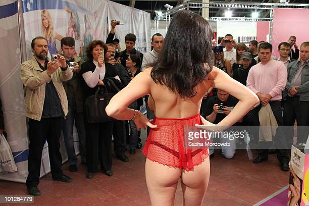 Female entertainers perform a striptease at The International Specialized XSHOW Exhibition for Adults 2010 on May 2010 in Moscow Russia The 3rd...