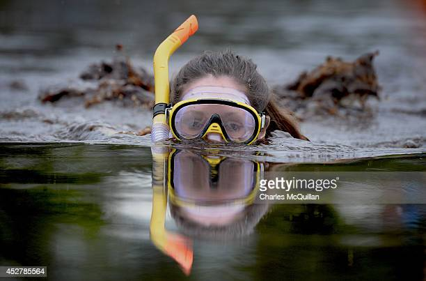 A female entrant takes part in the Irish Bog Snorkelling championship this afternoon at Peatlands Park on July 27 2014 in Dungannon Northern Ireland...