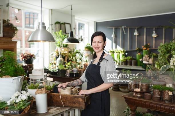 female entrepreneur at work in her florists boutique - denmark stock pictures, royalty-free photos & images