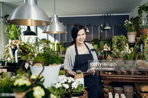 Female Entrepreneur At Work in Her Florists Boutique