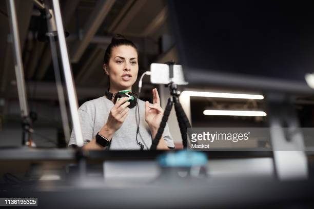 female entrepreneur giving presentation on solar toy car through conference call in creative office - artificial intelligence stock pictures, royalty-free photos & images