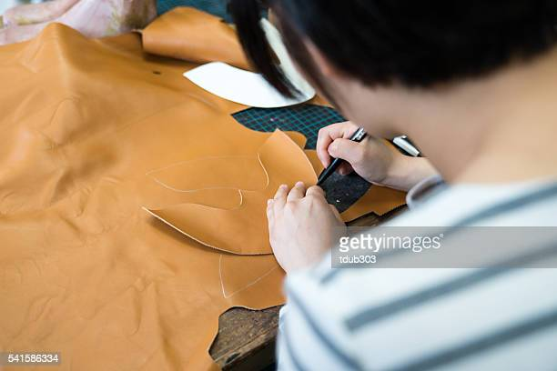 Female entrepreneur shoemaker working in her small shoe shop