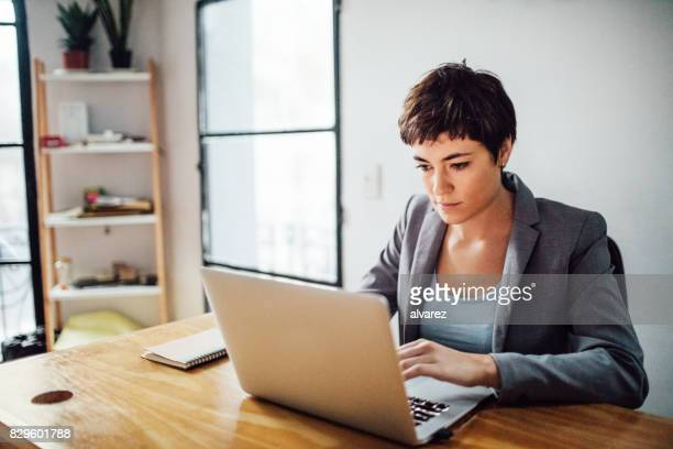 Female entrepreneur working on laptop at startup