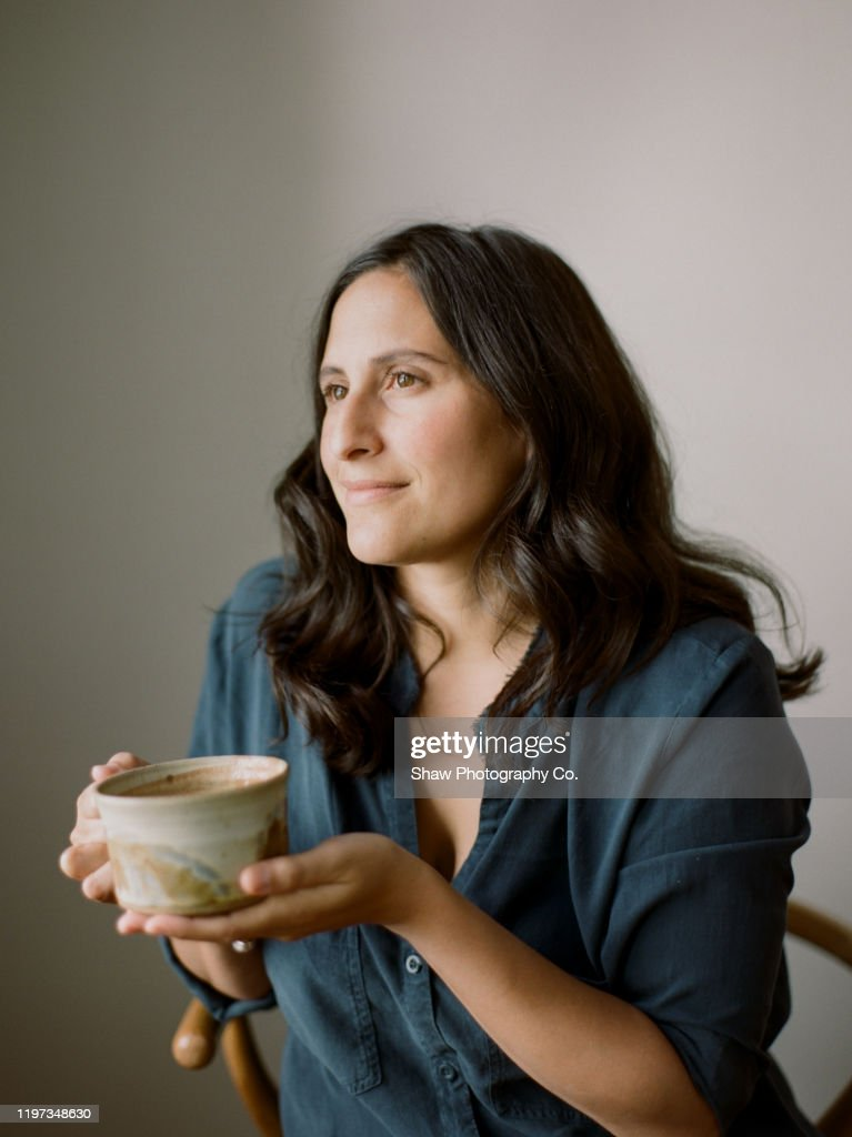 Female Entrepreneurial Mother Holding A Cup Of Coffee In A Beautiful Ceramic Pottery Cup Looking Out Window With A Look Of Contentment On Face High Res Stock Photo Getty Images