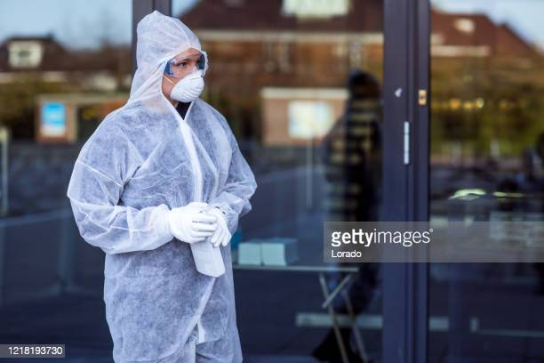 a female essential worker wearing a face mask during virus outbreak - essential workers stock pictures, royalty-free photos & images