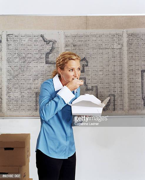 Female executive eating lunch from take-out box