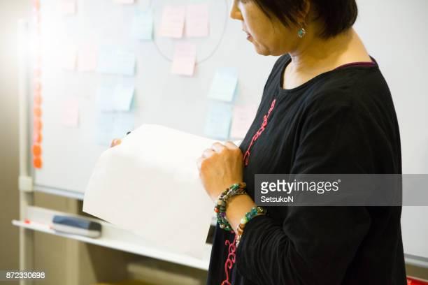 Female executive explaining new business idea to colleagues.