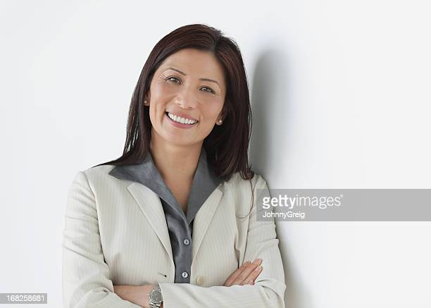 Female Executive Standing With Arms Crossed