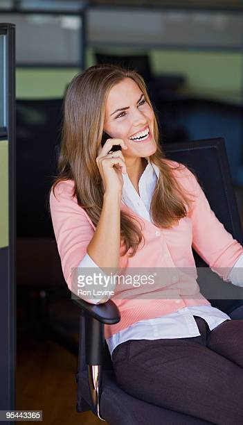 Female executive talking on her cellphone