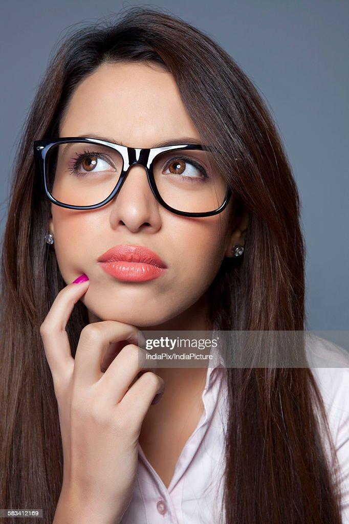 Female executive thinking : Stock Photo
