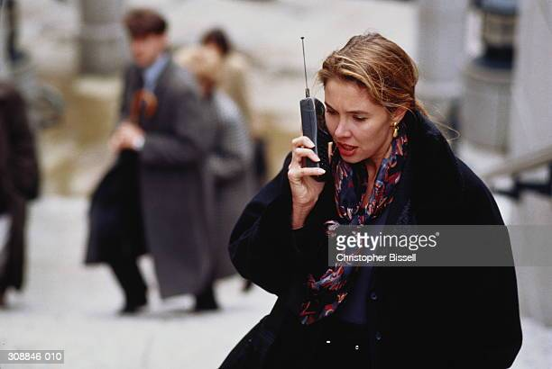Female executive using mobile phone outdoors