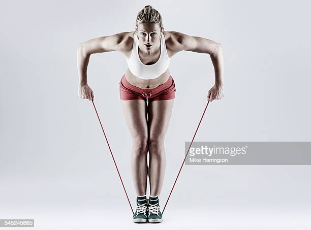 Female exercising, bent row with resistance band