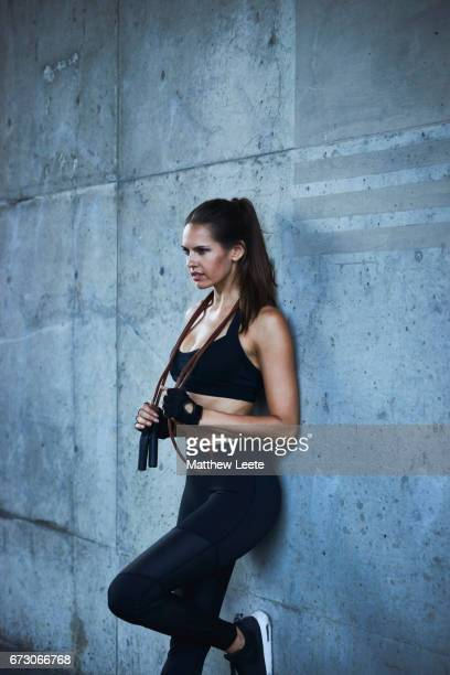 female exercising in urban area - matthew hale stock pictures, royalty-free photos & images