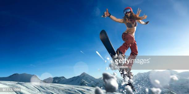 female extreme freestyle snowboarder jump - half pipe stock pictures, royalty-free photos & images