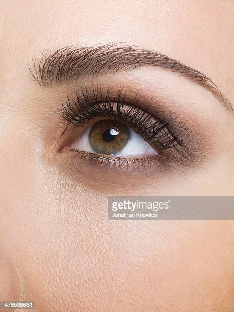 female eye looking up, close up - hazel eyes stock pictures, royalty-free photos & images