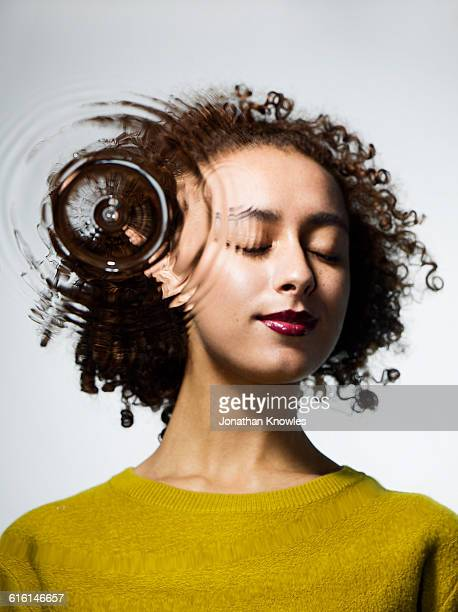 female eyes closed  through water with ripples - women in harmony stock pictures, royalty-free photos & images