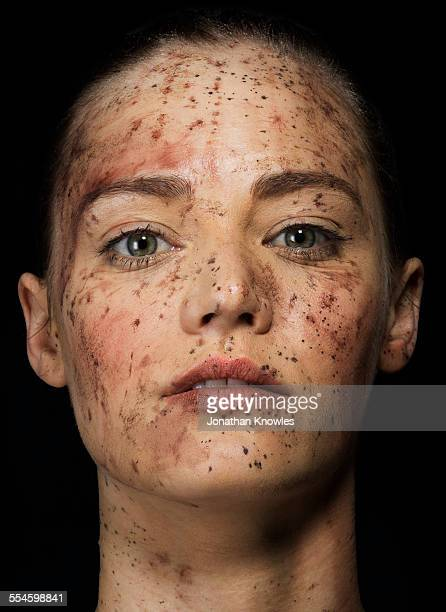 female face covered in mud - bruise stock pictures, royalty-free photos & images