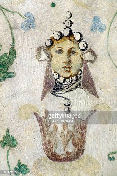 Female face fresco on the ceiling of the Sub Rosa hall Sarospatak castle BorsodAbaujZemplen Hungary 16th century
