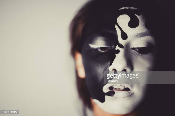 female face paint model closeup - crazy holiday models stock photos and pictures