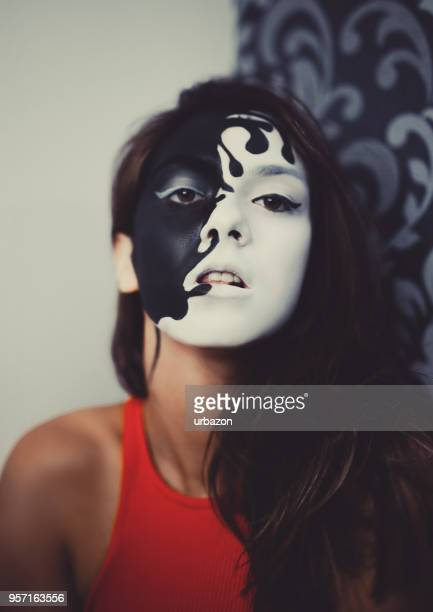 female face paint model - crazy holiday models stock photos and pictures