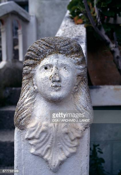 Female face relief on a balustrade village of Olympos Karpathos island Greece