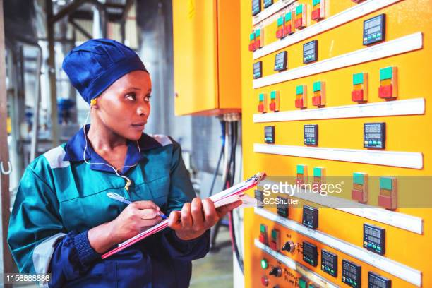 female factory engineer checking the electrical panel - africa stock pictures, royalty-free photos & images