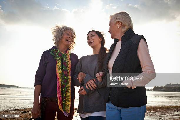 Female family members chatting on beach