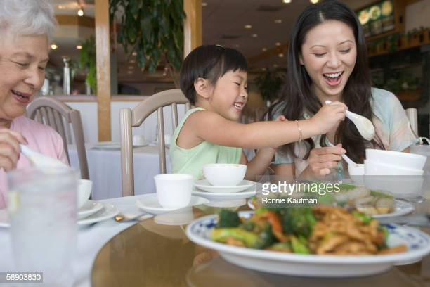 Female family members share a Chinese meal
