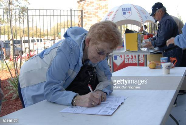 A female fan fills out her scorecard before the spring training game between the Toronto Blue Jays and the Detroit Tigers at Knology Park in Dunedin...